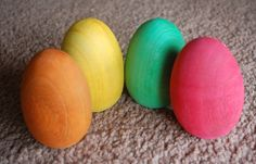 painting wooden toys with food colouring