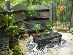Fence and furniture seem the perfect color to enhance the restful ambiance of this small patio. Sent in by Rate My Space contributor 10957180. >> Really wishing my outside space had a nook like this!