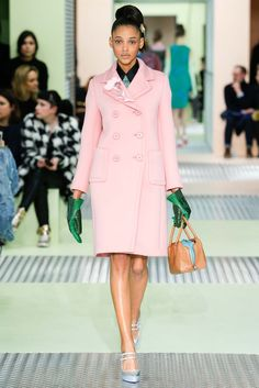 Prada F/W 2015 at MFW. Fascinatingly ugly—a feminine pink coat with a little flower, and then these Hulk-hands gloves.