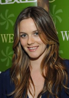 Alicia Silverstone -same style & she happens to be a personal mentor of mine.  I went Vegan b/c of her book & direction.