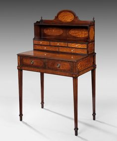 "An elegant Thomas Shertaon period mahogany veneered ""Bonheur du Jour"" (""Afternoon Delight"") (Late 1780-1800s)"