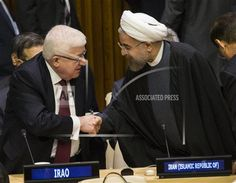 Iraqi President Fuad Masum, left, is greeted by Iranian President Hassan Rouhani as he arrives at the Climate Summit at United Nations headquarters, Tuesday, Sept. Iraqi President, United Nations Headquarters, Iranian, Tuesday, Presidents, Islam, Politics, Muslim, Political Books