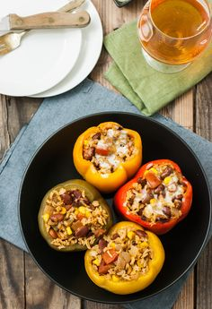 Slow Cooker Stuffed Bell Peppers with pinto beans, veggies, and enchilada sauce