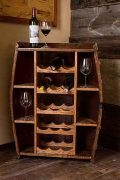 Our Wine Barrel Cabinet makes the perfect addition to any kitchen or bar, adding both rustic beauty as well as storage for plenty of bottles and accessories. Hand-crafted from an authentic oak wine barrel and carefully finished, this cabinet is sure to be a conversation piece in your home.  *Finished in rustic provincial stain and multiple coats of cabinet-grade lacquer. *Holds up to 15 wine bottles with room on each side for glasses and accessories. *Approximately 35 tall, 22 wide, and 11.5…