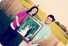 anniversary pic.. i like the whole holding your wedding photo :)