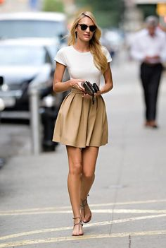 Here's another slimming tip for you. Try a high-waisted circle skirt. The waistband will hit at the smallest part of the torso and flare out over the stomach.