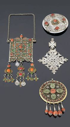 Southern Morocco and Anti Atlas region (Tiznit - Tafraout region) | Four pendants, one on a chain; silver, coral, enamel and green stones