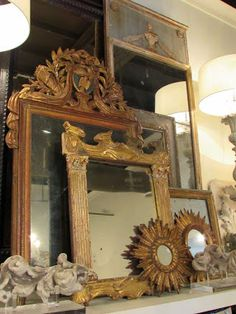 Layered mirrors on the mantel.