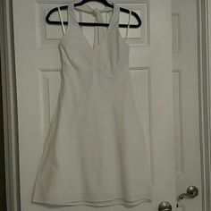 """Loft Halter Dress - Size 0 Super cute white halter dress from Loft. The fabric has a white on white stripe, see the third picture of a close up of the fabric.   Dress is lined so it isn't see through!  Hits about my knee and I am 5' 1""""  Great for spring and summer!   Gently worn with no stains, loose threads or damage. LOFT Dresses"""