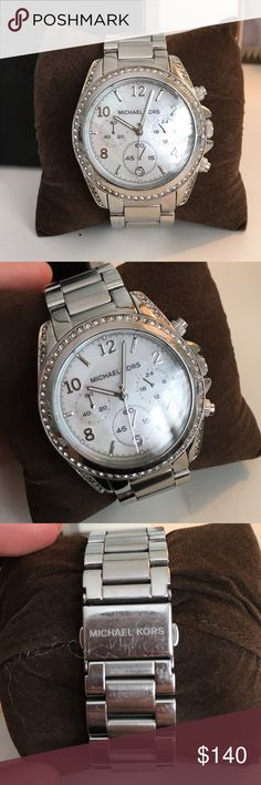 Michael Kors Watch Really good condition, very slight scuffing on some of the band from wear but the face is perfect. Comes with original box, info booklet and extra band links!! Michael Kors Jewelry