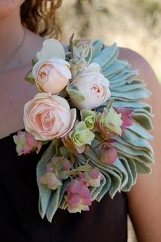 I KNOW this is over the top, but what about a very highly edited one, with the Lamb's Ears i.e. the soft velvety leaves, for your mothers?? Gorgeous!  Shoulder Corsage