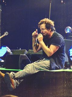 Walks up to stage, sits down straddling him, buries his face in my boobs while I play with those curls.