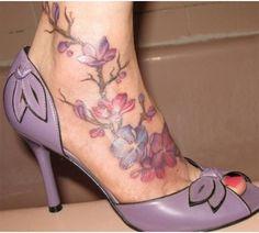 Sister tattoo... birth month flower ..... Best Foot Tattoo Designs - Our Top 10   StyleCraze