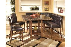 "The Lacey Counter Height Dining Room Table from Ashley Furniture HomeStore (AFHS.com). The rich contemporary design of the ""Lacey"" dining room collection features faux marble and a subtle rustic beauty to create a sophisticated atmosphere that is sure to enhance any dining experience."