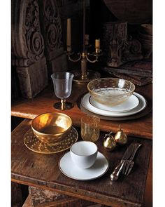 Emerson footed goblet by Juliska. Bronze Metal charger and Metallic Basso dinner and salad plates by Calvin Klein Home. Goto Gold Bubble bowl from Barneys New York. Balloton tumbler from Seguso. Pear salt-and-pepper shakers by Michael Aram.