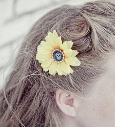 Yellow Sugar Skull Hair Flower by Sins 'n Needles - This pretty little hair flower is bright yellow, features sugar skull image, and is securely fastened to a silver tone alligator clasp. Measures approximately 3 inches across.