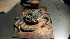 Check out this item in my Etsy shop https://www.etsy.com/listing/225310300/mech-tech-crab-pendant