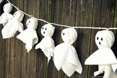 DIY Halloween Ghost decor- white sheets wrapped around patio light strings- just missing twine or ribbon BOO   =o