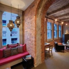 This wonderful brick and concrete apartment was an old warehouse in its former life.