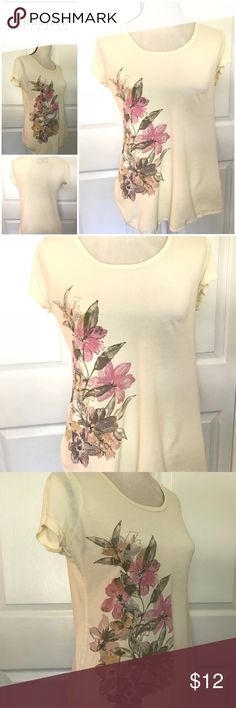 Motherhood Maternity T-Shirt Adorable cream color short sleeve tee with beautiful flowers down the right side. Extremely soft made of 100% Cotton. You will love this soft and comfortable maternity top. Motherhood Maternity Tops Tees - Short Sleeve