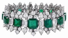 Emerald and diamond jewelry by Bulgari, given to Elizabeth Taylor by her husband, Richard Burton. The bracelet, earrings and necklace with detachable pendant/brooch were given as a parure, or set; the ring was a separate gift. The necklace and pendant/brooch are shown individually (second row from bottom) and joined (bottom).