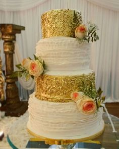 Gold sequins wedding cake with fresh flowers