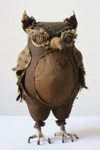 Amazing soft sculpture owl by artist Ann Wood, created with repurposed garments, quilts and blankets.