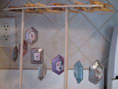 After the paper has been cut, glued and sanded, I dip the pendants 3 times in a gloss. I use Triple Thick DecoArt from Hobby Lobby.  I do add a little water to thin the solution.