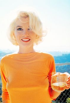 Marilyn is such a beauty in tangerine no less.  Plus wine, she rules. Marilyn Monroe.