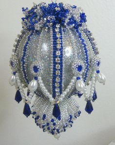 Ruffles - This is an instructional pattern for a highly ornate beaded Christmas ornament cover made of seed beads, glass pearls, fire polished