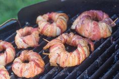Bacon-Wrapped Grilled Onion Rings.   Perfect for the #tailgate. Wrap onions in #bacon and toss them on the grill. #onionrings