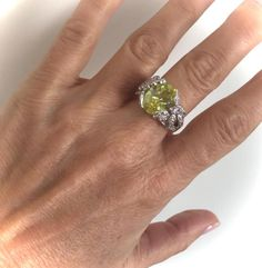 Gorgeously Brilliant Ring With a Beautiful Color Combination Features a Radiant Apple Green Center Stone Nestled In a Glistening Floral Setting Gorgeous From Every Angle and Full of Fire Truly Beautiful Would Pair Beautifully with Many Items In My Shop, Please Have a Look Through