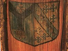 Coat of arms of Archbishop Richard Bancroft painted on fore-edge of Commentaria in titulum pandectarum, de regulis iuris... by Gulielmus Maynerius (1571) [*OA161.D5],