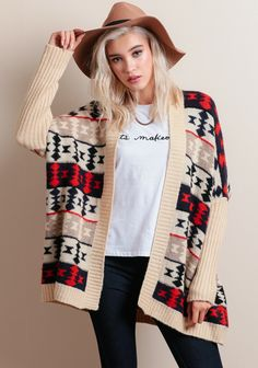 Complete with an oversized fit, ribbed detailing, and dolman sleeves, this rad cardigan can be layered over your basic pieces for a laidback transitional look.