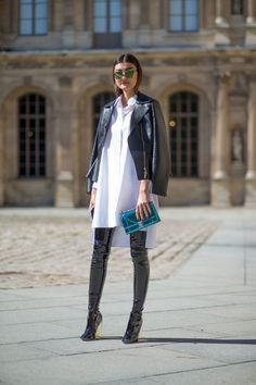 If you're a jeans-and-a-tee kind of gal, you'll like the simple combo of a black leather biker jacket and a white shirtdress. Black leather over the knee boots will instantly smarten up even the laziest of looks. Shop this look on Lookastic: https://lookastic.com/women/looks/biker-jacket-shirtdress-over-the-knee-boots/14122 — Green Sunglasses — Black Leather Biker Jacket — White Shirtdress — Teal Leather Clutch — Black Leather Over The Knee Boots
