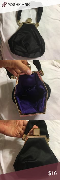 Black evening purse Matte black satin evening purse with gold color clasp and trim, has purple interior with a pocket for your lipstick, phone, ID, keys... Very elegant carry along for a fun evening out! Bags Mini Bags