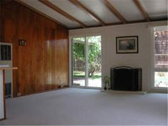 Paneling, brown beams and an old wall heater.