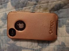 Black Otter Box defender case + gold/copper Krylon Fusion spray paint = perfect iPhone cover! 1) Separate the outer and inner cases. 2) Lightly and evenly spray outer case, back side, let dry for five minutes.  Flip case and repeat. 3) Apply second coat, following directions for step 2. 4) Let dry 15 minutes. 5) Apply clear coat /sealant, let dry for one hour. 6) Reassemble your case.  :)  For touch ups, spray metallic paint onto a q-tip, saturating the cotton.  Dab onto case where needed!
