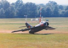 This pilot nearly buys the farm at the bottom of a loop. The tail strike occurred during at a 1990 airshow in Harrison, Arkansas. Photographer, who was a technician for the FAA and somewhat of a camera buff, was tracking with his camera, as this guy looped off the deck in a MiG-17. The pilot had just completed a loop and misjudged his pull-out. Everyone considering themselves as potential victims, took-off running in all directions.