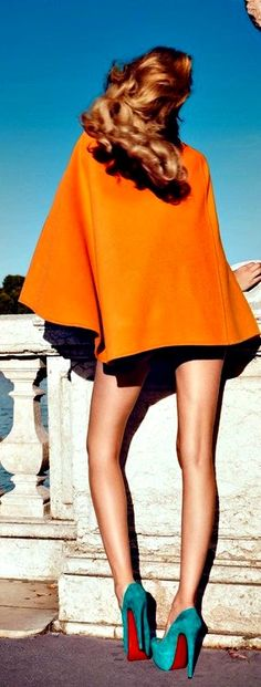 "Gorgeous legs, gorgeous heels, gorgeous orange top....  In orther words, ""gorgeous""!"
