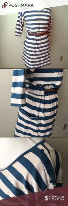 """Teal and Cream dress This is a lovely teal and cream striped dress with a brown belt, two side pockets, and elasticized waist. In good used condition with no stains, tears, holes, etc. Tag says size large but probably fits a medium the best. Use my measurements to guide you. Shoulder to shoulder is 21"""", pit to pit is 19.5, waist is 12"""" unstretched and 20"""" stretched, length is 34"""". Poof! Dresses"""