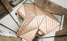 When A Copper Roof Steals The Show In A Working Environment...  Emrys Architects