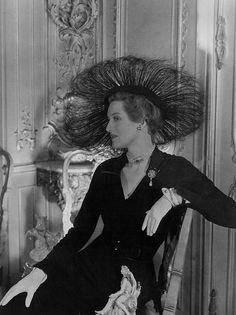 June 1949 Mrs Leo d'Erlanger is wearing a hat by Vernier for British Vogue.
