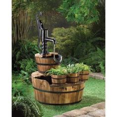Old Fashioned Water Pump Barrel Fountain. This old fashioned pump and barrels make a very rustic display in your yard or patio. The three smaller half barrel planters in front add to its beauty. You'll love it with some trailing plants in front of some flowering plants!