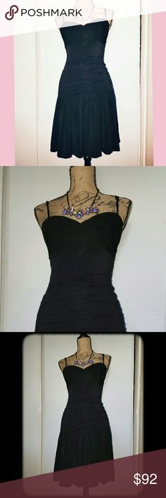 Stunning Silhouette Couture Black Dress NWOT!! Stunning Little Black Dress. Absolutely gorgeous!!  With emphasized shaped bust with slight plunge...just enough. Adjustable spaghetti straps. Silhouette style. Stunning ribbed detail. Built in lining. Perfect for summer nights out, cocktail parties, special occasions, date night, a must-have for your littlemail black couture collection. Perfect condition. New without tags. Never worn! New!! Materials:  92% Polyester  60% Acetane  2% Spandex…