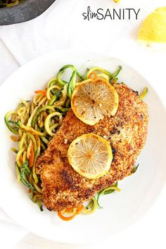 Almond crusted chicken with lemon zucchini noodles is a delicious dinner dish with a gourmet feel you can prepare in 20 minutes or less! | slimsanity.com