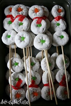Snowman on a stick. white powdered donuts.