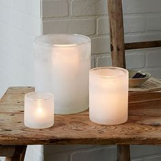 Use DYI method of sea glass to make WHITE hurricane candles for the holidays- these are from WestElm
