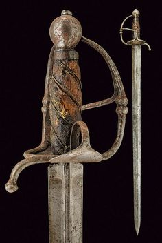 Walloon Sword, 3rd quarter of the 17th century, Straight, double-edged blade of hexagonal section; with fullers at the forte and short tang, length 97 cm. from  http://www.invaluable.com/auction-lot/a-walloon-sword-517-c-25549ec9f1