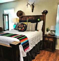 One of the perks of moving.... getting to redecorate your stuff! Nothing wrong with serape, leopard and stained wood right!?!?!? #serape #leopardprint #stainedwood #bedroomdecor #westernchic #westernstyle #fortheloveofcolor #interiordesign @rhr_furniture_granbury